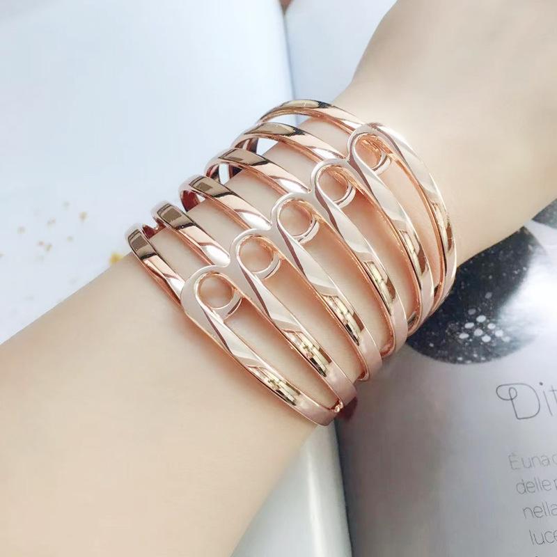 Gold plated hollow metal open cuff bracelet